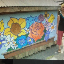 Maddie with a mural she designed